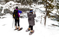 Snowshoers taking Photos at McDonald Creek Falls