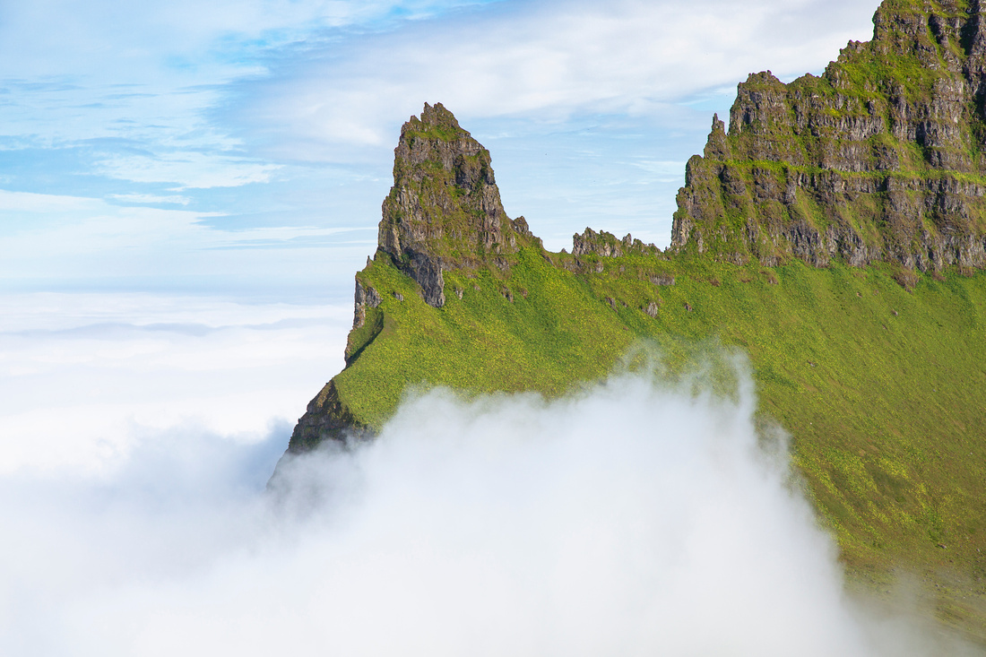 Hornbjarg rising above the clouds
