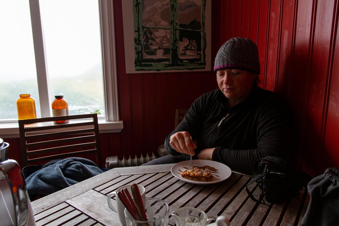 Corrie enjoying Rhubarb cake in Hesteyri