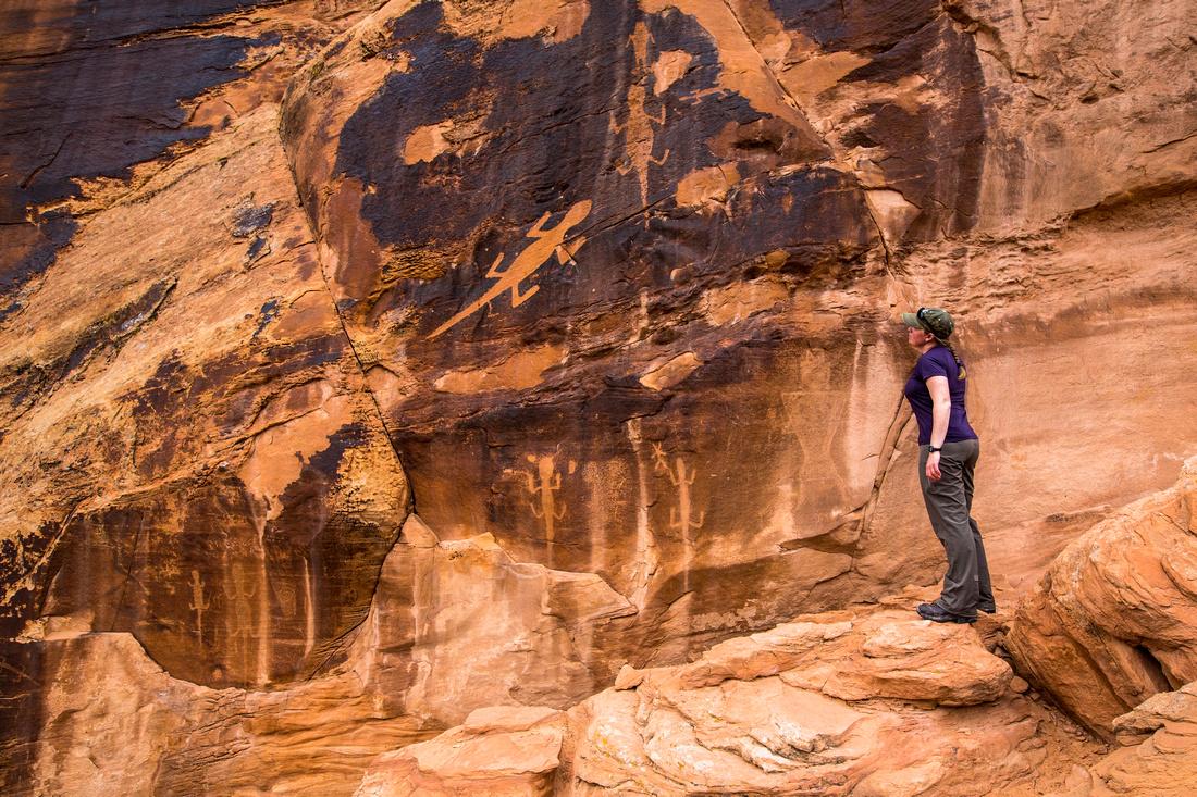 Hiker viewing the petroglyphs