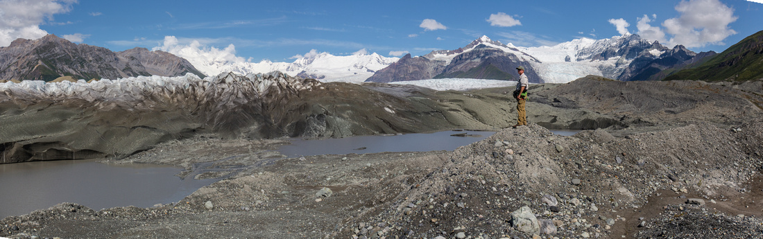 Hiker viewing Kennicott Glacier near Wilderness Boundary - Donoho Basin